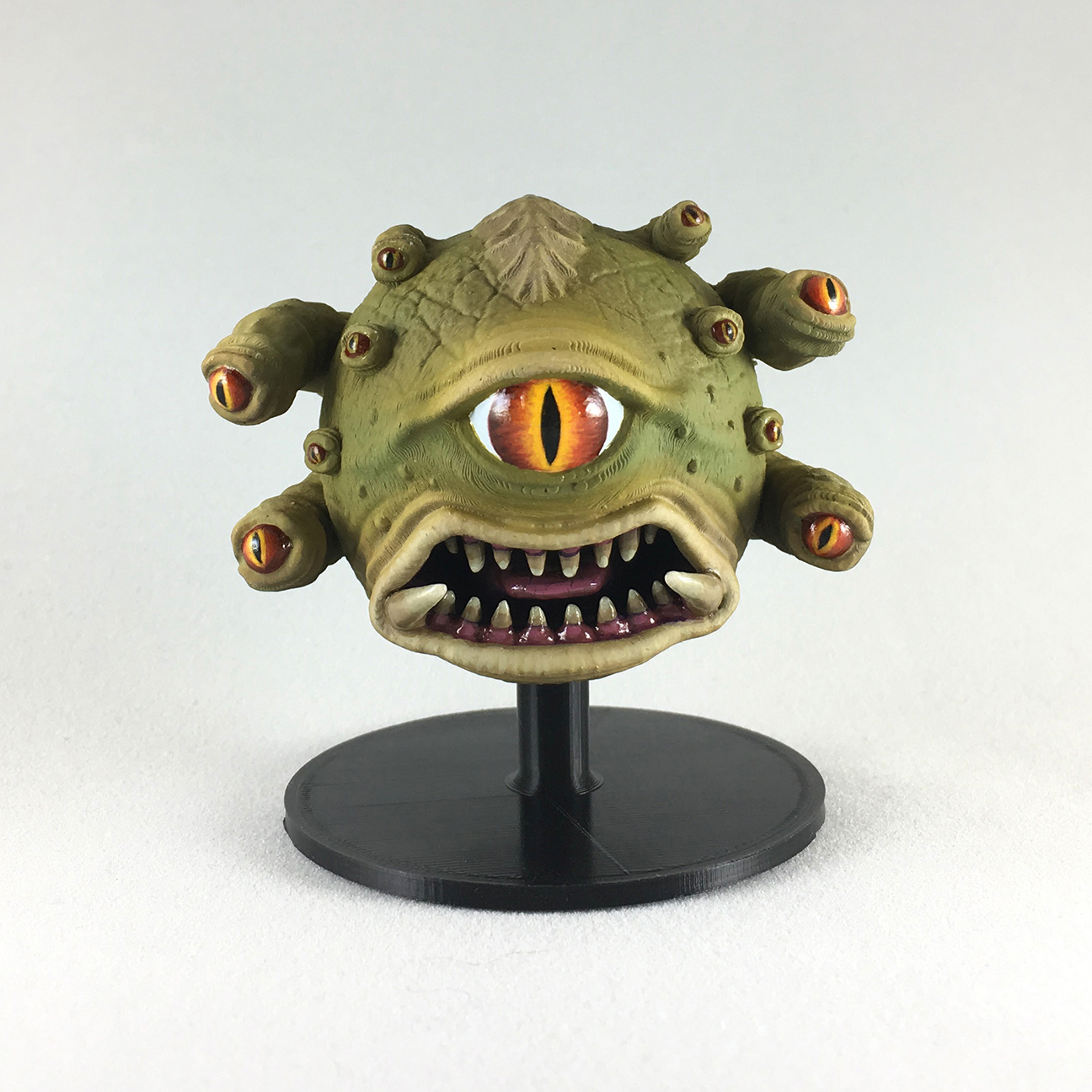 Angry Ball of Eyes upper body shown on included painting stand.  Upper and lower body sections can be painted separately thenglued together.